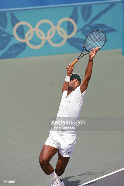 Leander Paes of India serves to Andre Agassi during the XXVI Olympic Games tennis men's semifinals at the Stone Mountain Tennis Center on August 1...