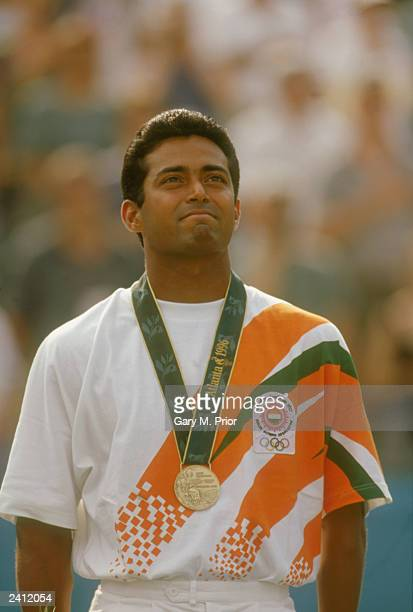 Leander Paes of India stands on the podium after winning a bronze medal in the men's singles tennis event at the 1996 Summer Olympic Games in Atlanta...