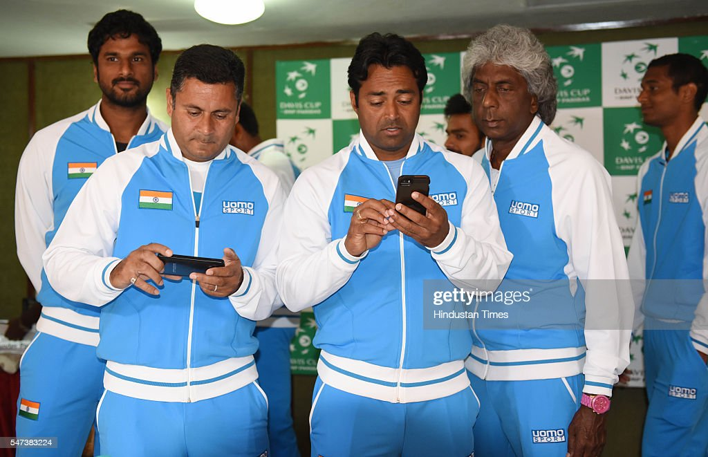 Leander Paes with Coach Zeeshan Ali and Anand Amritraj after the draw ceremony of Davis Cup between India and Korea at Haryana Raj Bhawan on July 14..