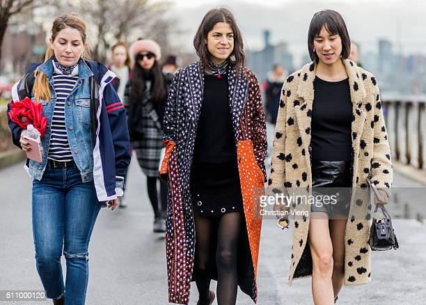 Leandra Medine and Eva Chen wearing a Thakoon coat seen outside Coach during New York Fashion Week: Women's Fall/Winter 2016 on February 16, 2016 in...