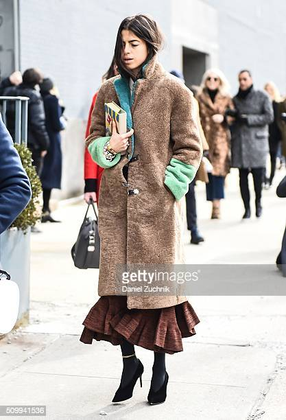 Leandra Medine is seen outside the Jason Wu show wearing a Saks Potts brown and green coat during New York Fashion Week Women's Fall/Winter 2016 on...