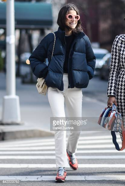 Leandra Medine is seen wearing a blue puff jacket and pink sunglasses outside the Marc Jacobs show during New York Fashion Week Women's Fall/Winter...