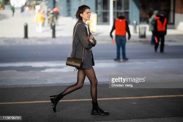 Leandra Medine is seen wearing sheer tights outside Tory Burch during New York Fashion Week Autumn Winter 2019 on February 10 2019 in New York City