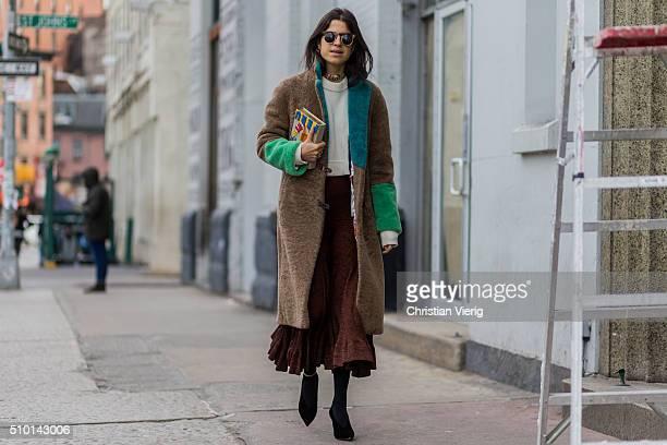 Leandra Medine is wearing a long brown green fake fur coat seen outside Jason Wu during New York Fashion Week Women's Fall/Winter 2016 on February 12...