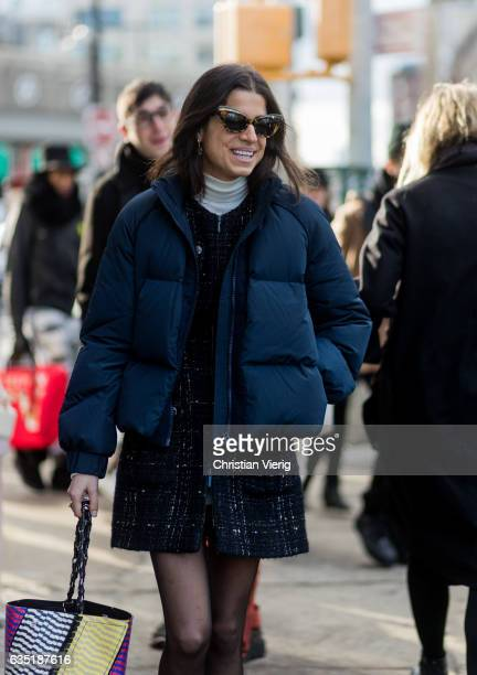 Leandra Medine wearing a navy down feather jacket outside 31 Phillip Lim on February 13 2017 in New York City