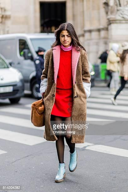 Leandra Medine wearing a Saks Potts coat red jumper and skirt outside Stella McCartney during the Paris Fashion Week Womenswear Fall/Winter 2016/2017...