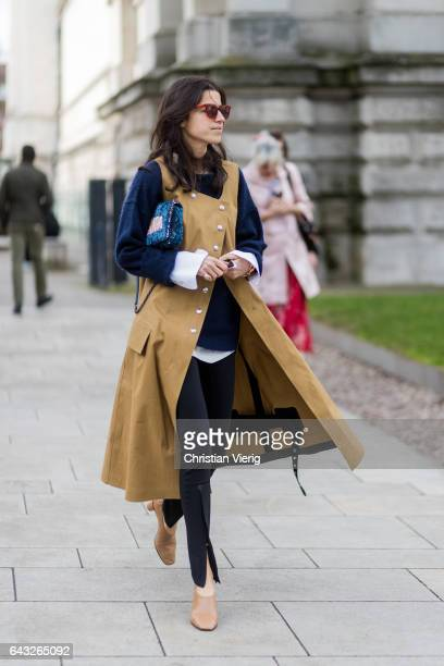Leandra Medine wearing a sleevless beige coat outside Christopher Kane on day 4 of the London Fashion Week February 2017 collections on February 20...