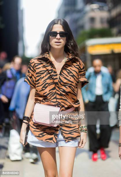 Leandra Medine wearing tiger print seen in the streets of Manhattan outside Derek Lam during New York Fashion Week on September 11 2017 in New York...