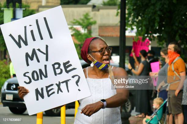 """Leandrea Brantle from Roslindale holds a sign asking """"Will my son be next?"""" at A Silent Vigil for Black Lives in Adams Park in Boston on June 4,..."""