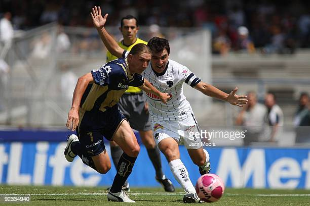 Leandro Augusto of Pumas and Luis Ernesto Perez of Monterrey during their match in the 2009 Opening tournament the closing stage of the Mexican...