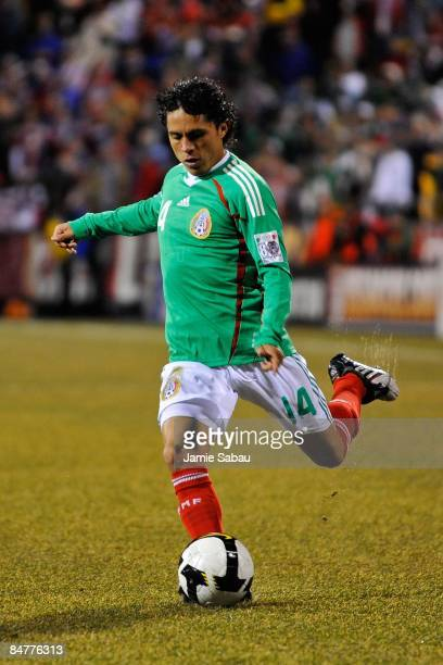 Leandro Augusto Oldoni of Mexico kicks the ball against USA during a FIFA 2010 World Cup qualifying match in the CONCACAF region on February 11 2009...