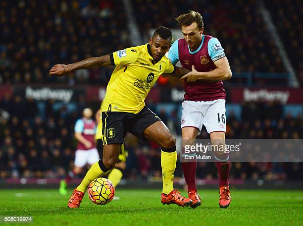 Leandro Bacuna of Aston Villa and Mark Noble of West Ham United compete for the ball during the Barclays Premier League match between West Ham United...