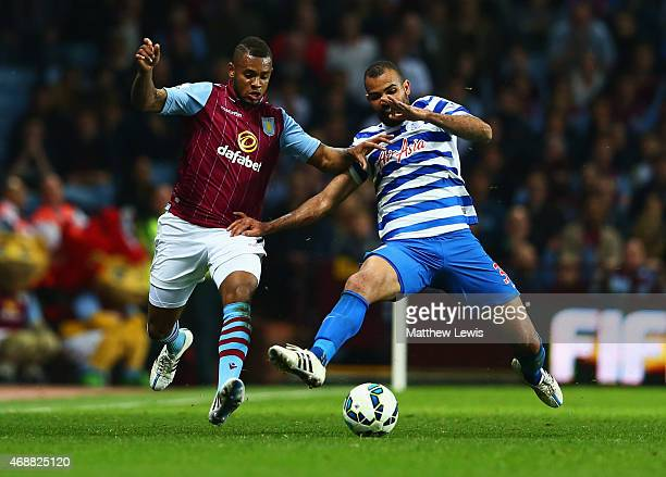 Leandro Bacuna of Aston Villa and Sandro of QPR battle for the ball during the Barclays Premier League match between Aston Villa and Queens Park...