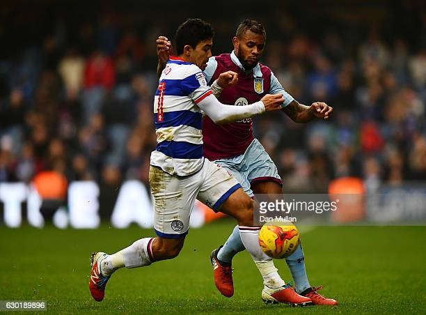 Leandro Bacuna of Aston Villa battles for the ball with Massimo Luongo of Queens Park Rangers during the Sky Bet Championship match between Queens...