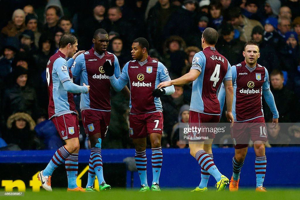 Leandro Bacuna (C) of Aston Villa celebrates after scoring a goal with team mates during the Barclays Premier League match between Everton and Aston Villa at Goodison Park on February 1, 2014 in Liverpool, England.