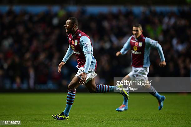 Leandro Bacuna of Aston Villa celebrates after scoring his team's opening goal during the Barclays Premier League match between Aston Villa and...