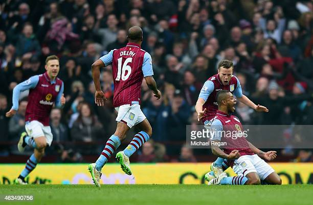 Leandro Bacuna of Aston Villa celebrates scoring the opening goal with Tom Cleverley snd Fabian Delph of Aston Villa during the FA Cup fifth round...