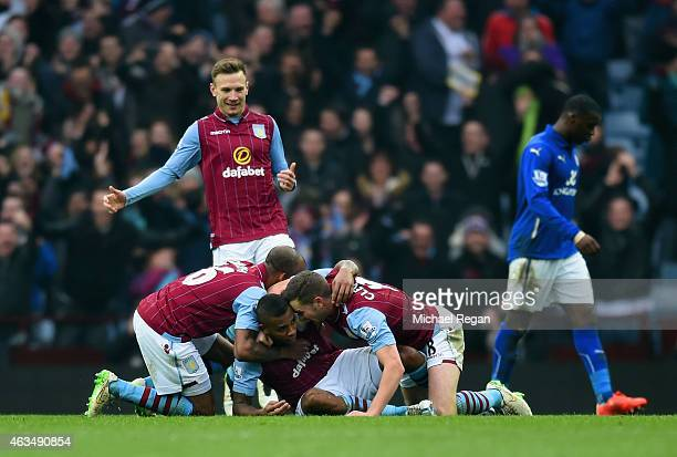 Leandro Bacuna of Aston Villa celebrates scoring the opening goal with team mates during the FA Cup fifth round match between Aston Villa and...