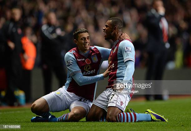 Leandro Bacuna of Aston Villa celebrates with teammate Matthew Lowton after scoring the opening goal during the Barclays Premier League match between...