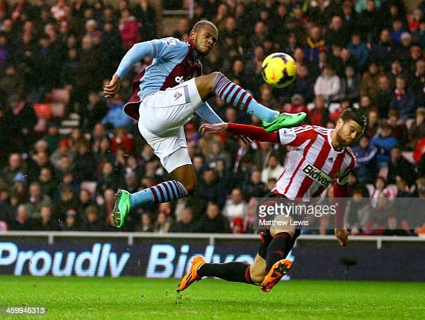 Leandro Bacuna of Aston Villa challenges Ondrej Celustka of Sunderland during the Barclays Premier League match between Sunderland and Aston Villa at...