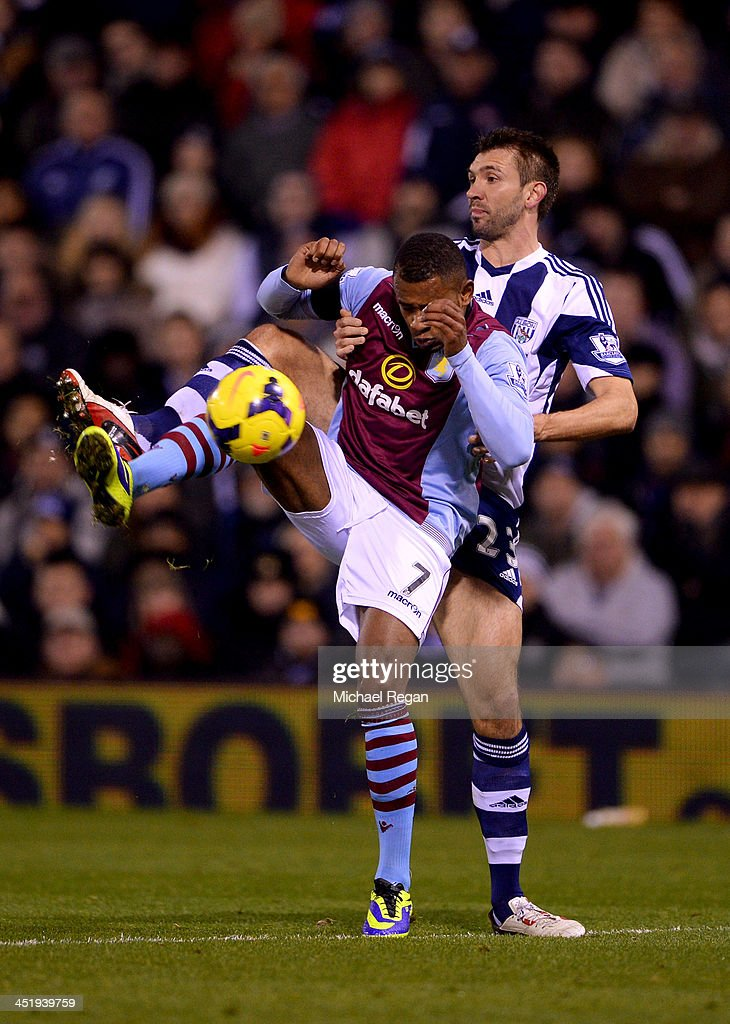 Leandro Bacuna of Aston Villa holds off Gareth McAuley of West Bromwich Albion during the Barclays Premier League match between West Bromwich Albion and Aston Villa at The Hawthorns on November 25, 2013 in West Bromwich, England.