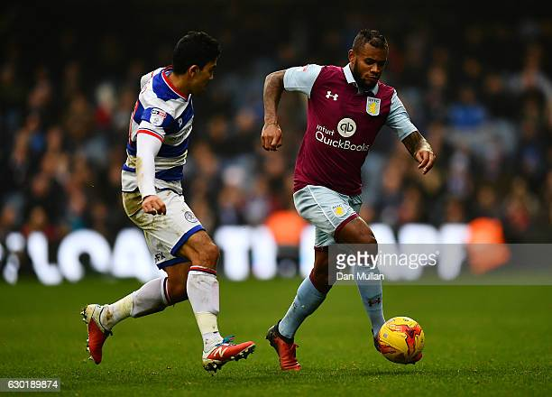 Leandro Bacuna of Aston Villa holds off Massimo Luongo of Queens Park Rangers during the Sky Bet Championship match between Queens Park Rangers and...