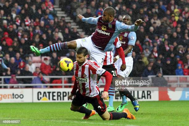 Leandro Bacuna of Aston Villa is blocked by Ondrej Celustka of Sunderland during the Barclays Premier League match between Sunderland and Aston Villa...