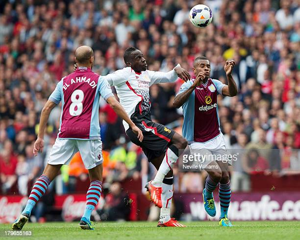 Leandro Bacuna of Aston Villa is challenged by Aly Cissokho of Liverpool during the Barclays Premier League match between Aston Villa and Liverpool...