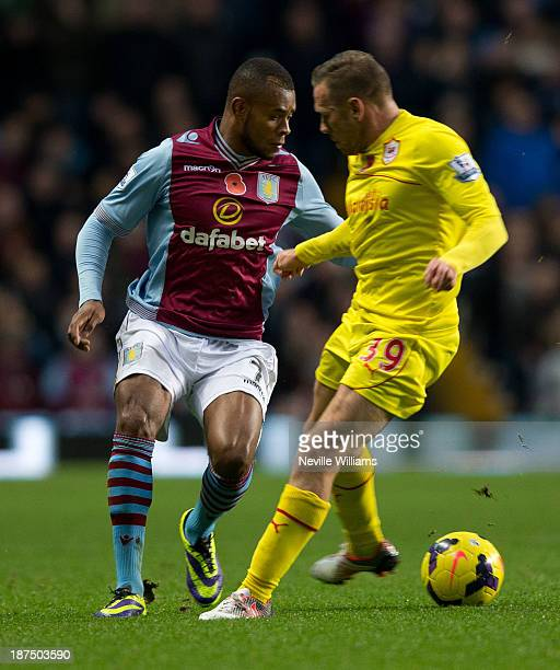 Leandro Bacuna of Aston Villa is challenged by Craig Bellamy of Cardiff City during the Barclays Premier League match between Aston Villa and Cardiff...