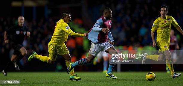 Leandro Bacuna of Aston Villa is challenged by Gary Medel of Cardiff City during the Barclays Premier League match between Aston Villa and Cardiff...