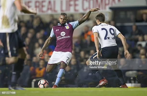 Leandro Bacuna of Aston Villa is challenged by Harry Winks of Tottenham Hotspur during the FA Cup Third Round match between Tottenham Hotspur and...
