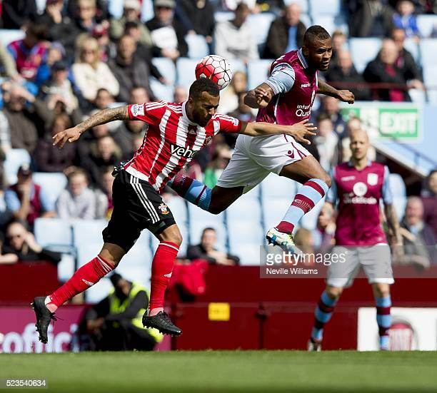 Leandro Bacuna of Aston Villa is challenged by Ryan Bertrand of Southampton during the Barclays Premier League match between Aston Villa v...