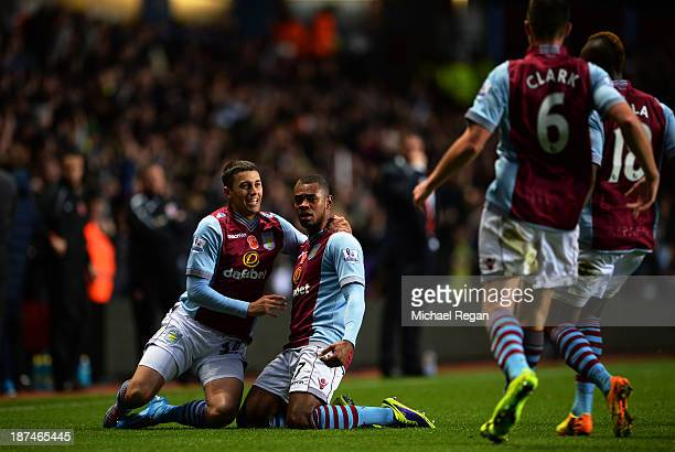 Leandro Bacuna of Aston Villa is congratulated by teammates after scoring the opening goal during the Barclays Premier League match between Aston...