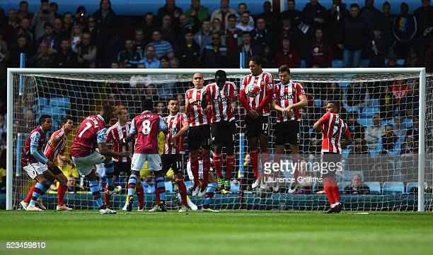 Leandro Bacuna of Aston Villa strikes a freekick during the Barclays Premier League match between Aston Villa and Southampton at Villa Park on April...