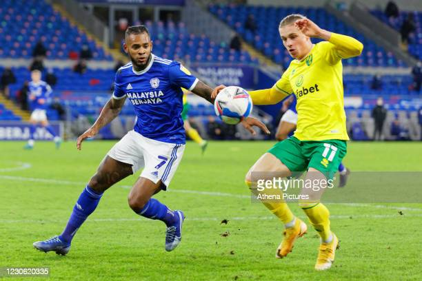 Leandro Bacuna of Cardiff City and Przemyslaw Placheta of Norwich City in action during the Sky Bet Championship match between Cardiff City and...