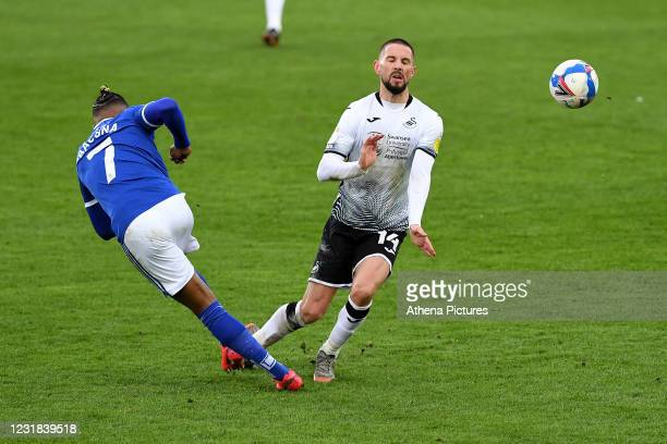 Leandro Bacuna of Cardiff City battles with Conor Hourihane of Swansea City during the Sky Bet Championship match between Swansea City and Cardiff...