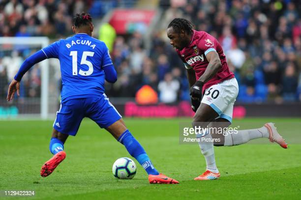 Leandro Bacuna of Cardiff City battles with Michail Antonio of West Ham United during the Premier League match between Cardiff City and West Ham...