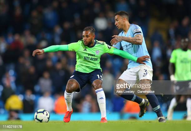Leandro Bacuna of Cardiff City holds off a challenge from Danilo of Manchester City during the Premier League match between Manchester City and...