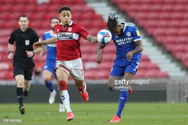 Leandro Bacuna of Cardiff City in action with Marcus Tavernier of Middlesbrough during the Sky Bet Championship match between Middlesbrough and...