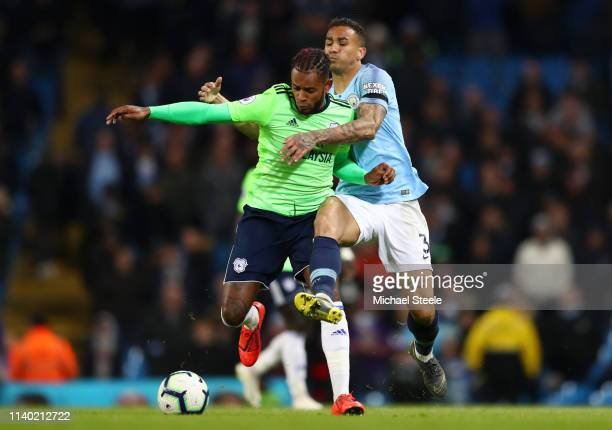 Leandro Bacuna of Cardiff City is challenged by Danilo of Manchester City during the Premier League match between Manchester City and Cardiff City at...