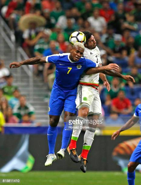Leandro Bacuna of Curacao goes for a header against Moises Munoz of Mexico in the second half during the 2017 CONCACAF Gold Cup at Alamodome on July...