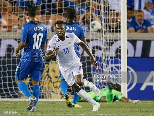Leandro Bacuna of Curacao scores against the Honduras in the first half during the CONCACAF Gold Cup Group C game between Honduras and Curacao at...