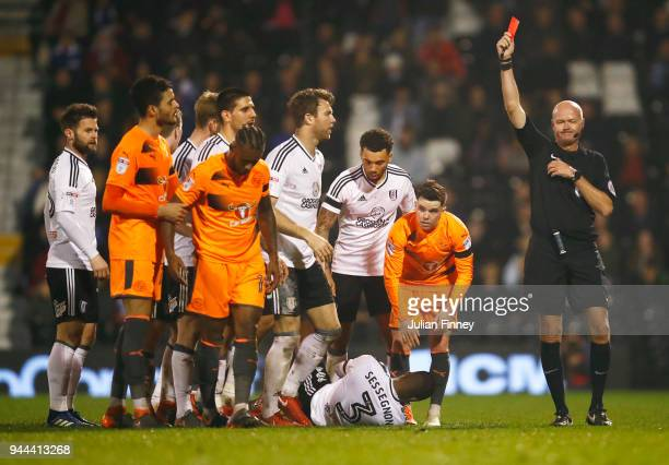 Leandro Bacuna of Reading is shown a red card by referee Lee Mason during the Sky Bet Championship match between Fulham and Reading at Craven Cottage...