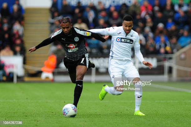 Leandro Bacuna of Reading vies for possession with Martin Olsson of Swansea City during the Sky Bet Championship match between Swansea City and...