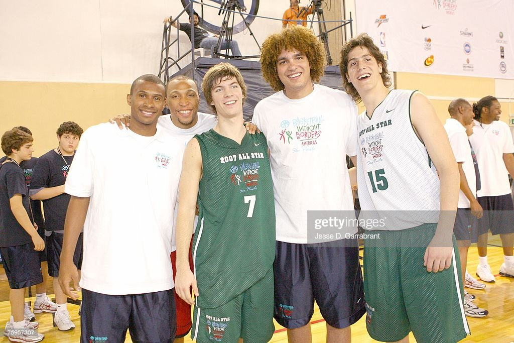 Leandro Barbosa and Shawn Marion of the Phoenix Suns, and Anderson Varejao of the Cleveland Cavaliers take a photo with some campers at the Pinheiros Sports Club during Basketball Without Borders on August 3, 2007 in Sao Paulo, Brazil.