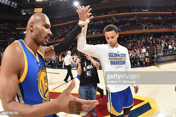 Leandro Barbosa and Stephen Curry of the Golden State Warriors highfive after a victory over the Cleveland Cavaliers in Game Four of the 2015 NBA...