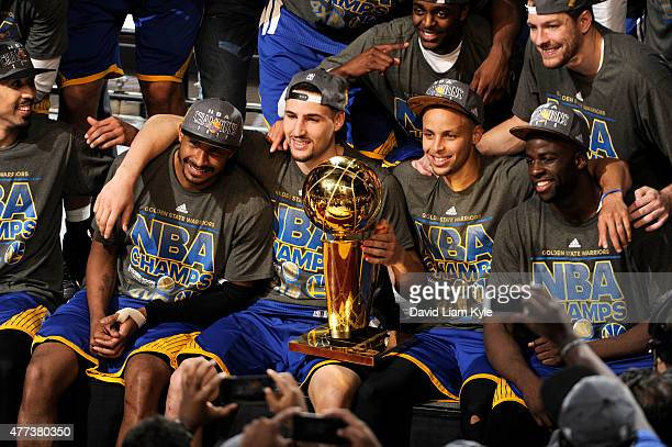 Leandro Barbosa, Klay Thompson, Stephen Curry, and Draymond Green of the Golden State Warriors celebrate winning the 2015 NBA Finals after a win...