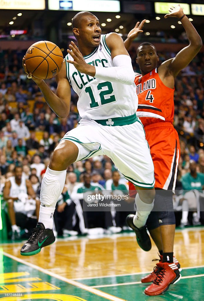 Leandro Barbosa #12 of the Boston Celtics passes the ball while jumping out of bounds in front of Nolan Smith #4 of the Portland Trail Blazers during the game on November 30, 2012 at TD Garden in Boston, Massachusetts.