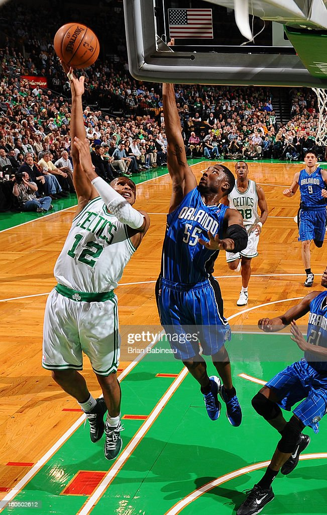 Leandro Barbosa #12 of the Boston Celtics shoots against E'Twaun Moore #55 of the Orlando Magic on February 1, 2013 at the TD Garden in Boston, Massachusetts.