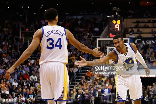 Leandro Barbosa of the Golden State Warriors high-fives Shaun Livingston during the NBA game against the Phoenix Suns at Talking Stick Resort Arena...